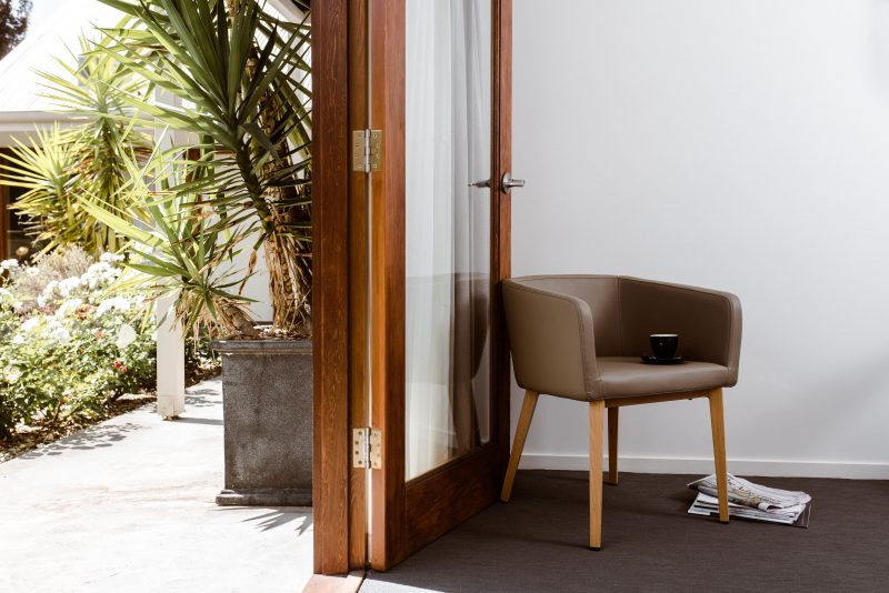 A Scandinavian-style seat back on to a garden