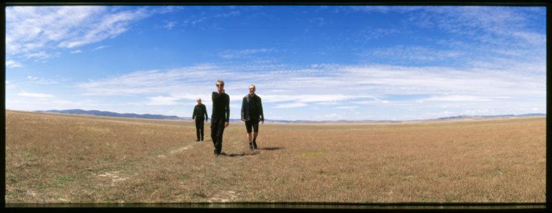 Image of The Necks walking across barren lands