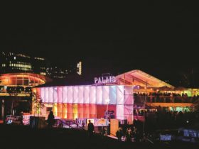 The Palais is illuminated on the River Torrens at night