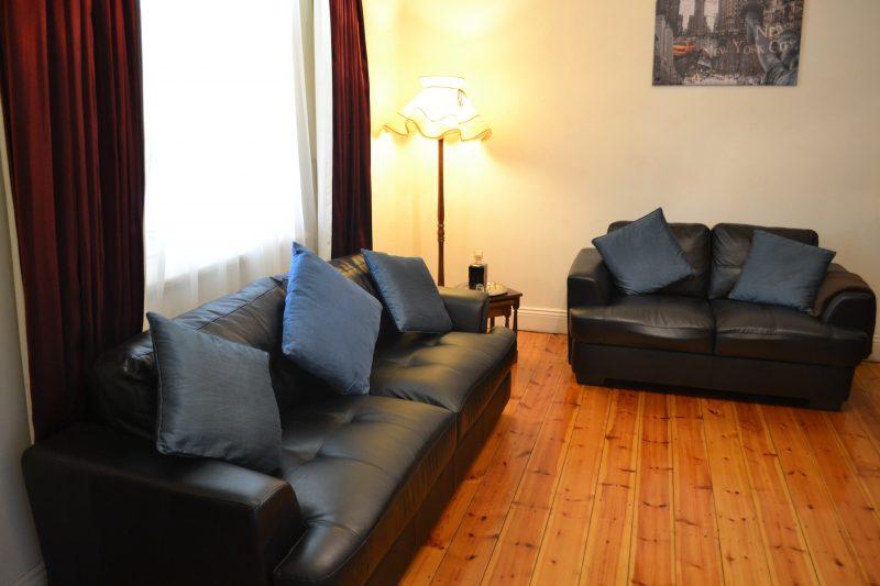 comfortable lounge and love seat on hard wood floors