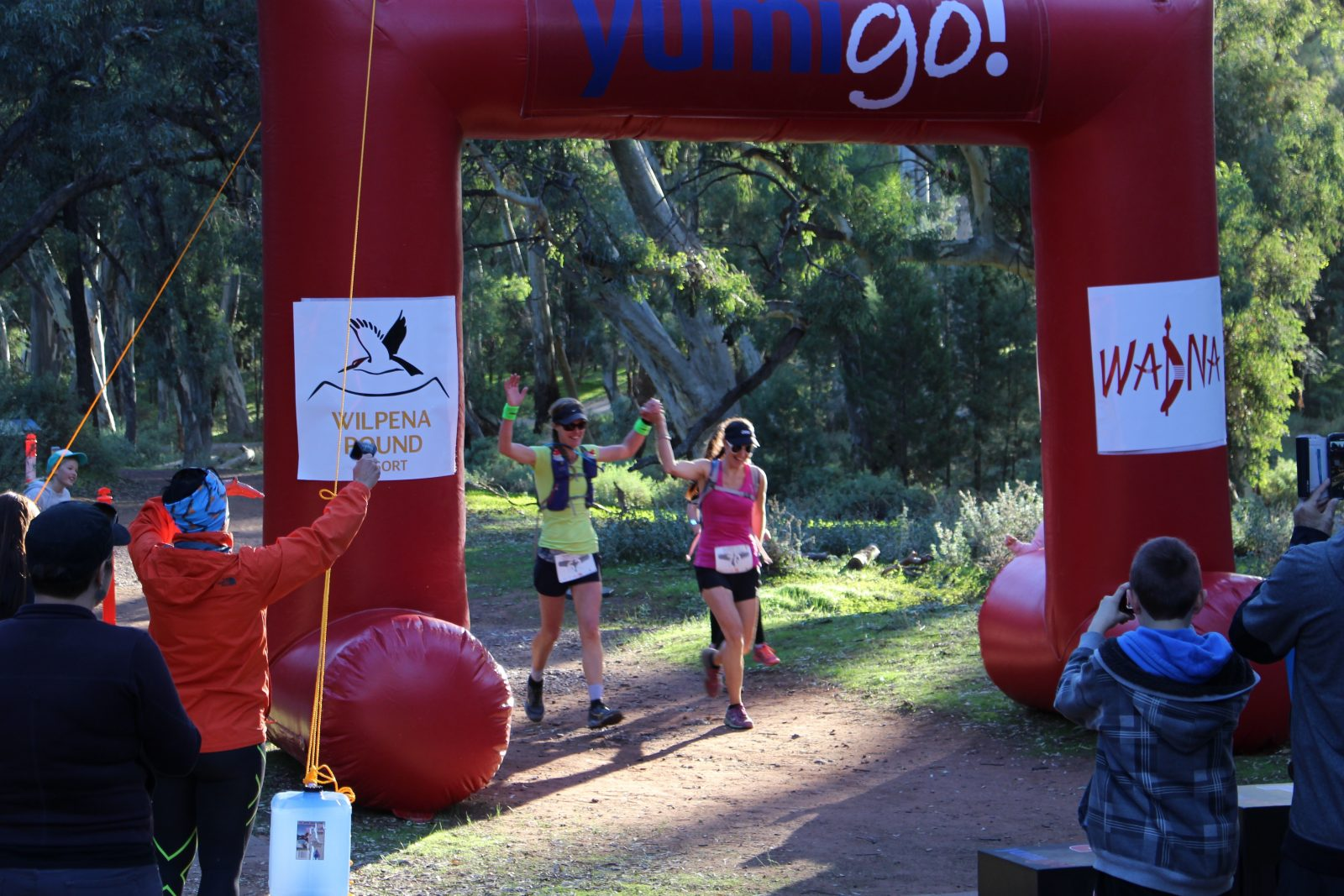 Experience the exhilaration and relief of crossing the finish line at the Hubert 100