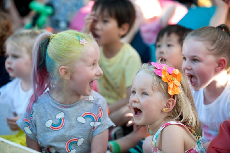 Children laughing at performance