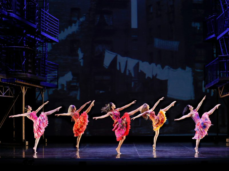 West Side Story - five female dancers all in a line kicking their leg high