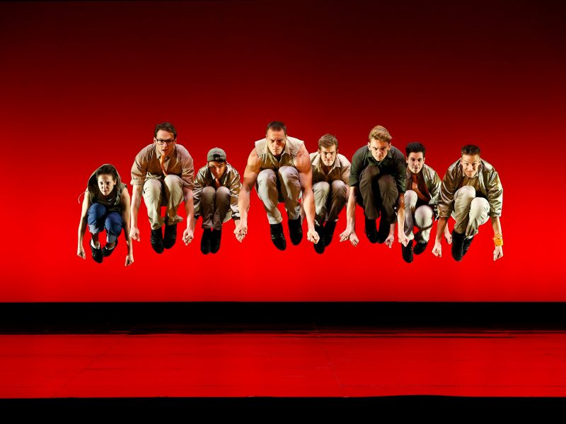 West Side Story - eight male dancers jump in synchronisation