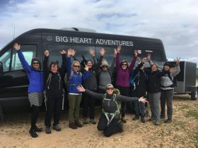 Wise Women Walking Big Heart Adventures Weekender Grampians. Women waving in front of black vehicle