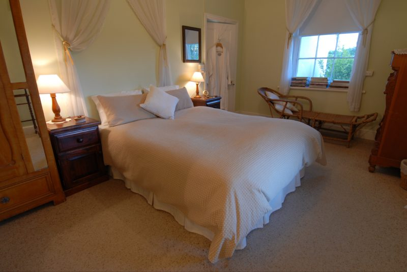 Guest bedroom with beautiful views from queen size bed