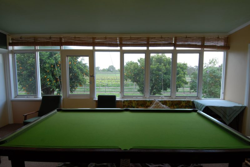 Guest sunroom with vineyard views, pool table & TV
