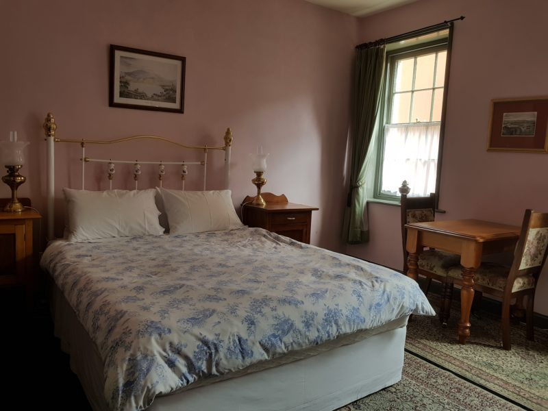 Samuel Bendall room - warm and comfortable queen bed with white linen