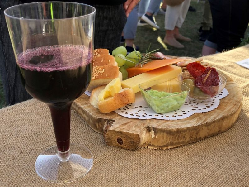 Glass of wine and the famous Bridport Girl Guides Cheese Platters all made from local ingredients
