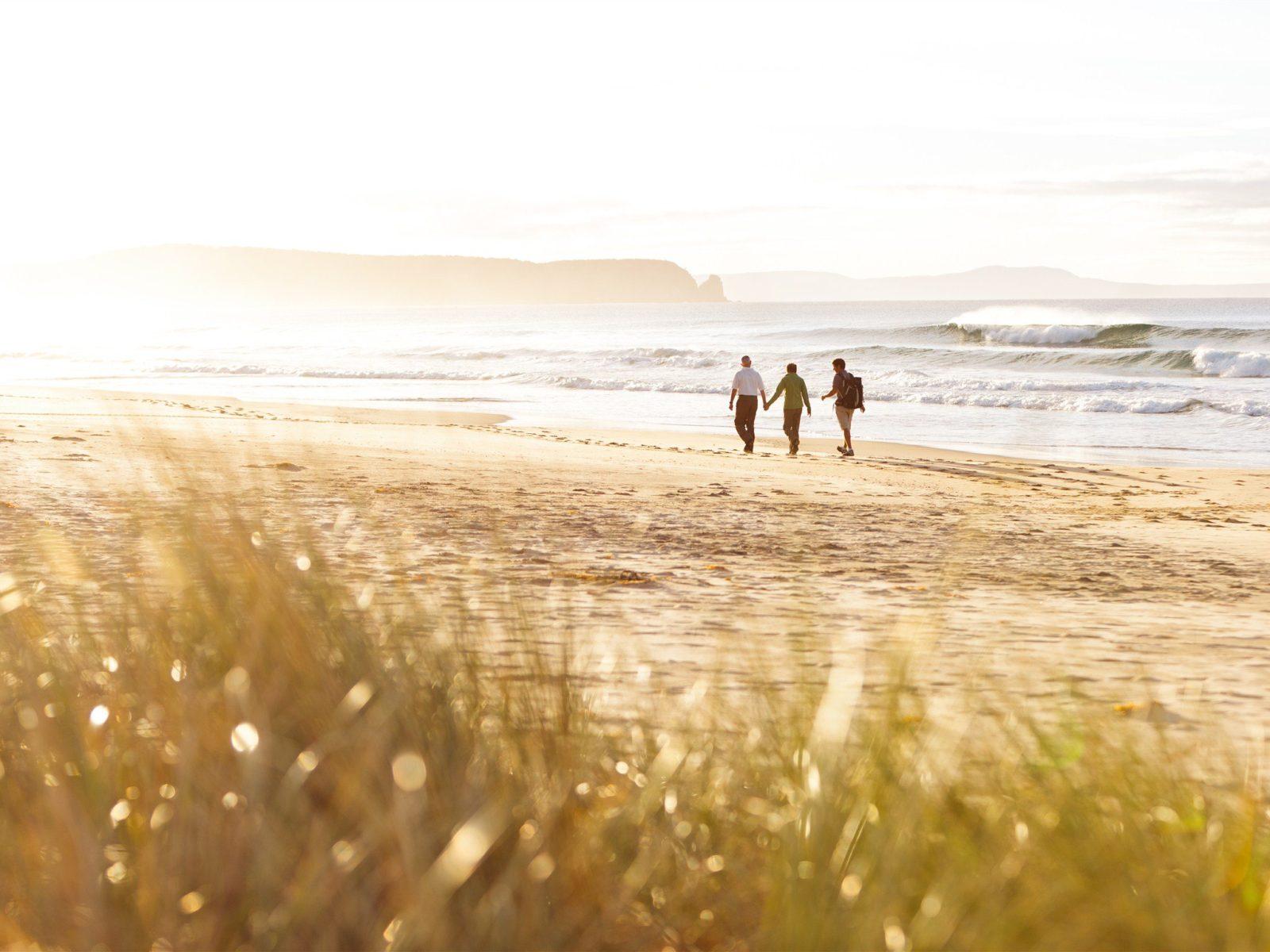 Couple walking along neck beach, Bruny Island