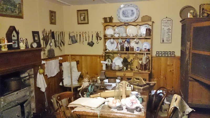Kitchen with furniture, implements, crockery