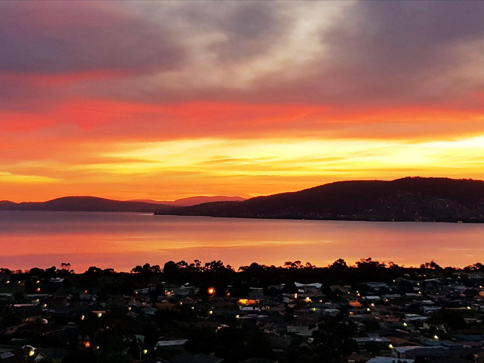 Pure mgic as the sun sets over Hobart as seen from Charbella's.