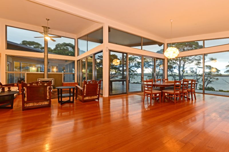 Lounge dining and fireplace out onto deck and Cloudy Bay Lagoon