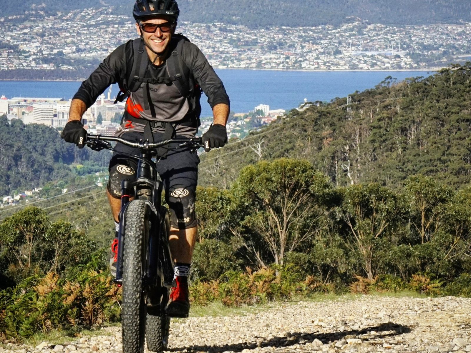 eBikes make climbing fun! High above Hobart.