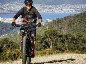 eBikes make climbing fun! High above Hobart.