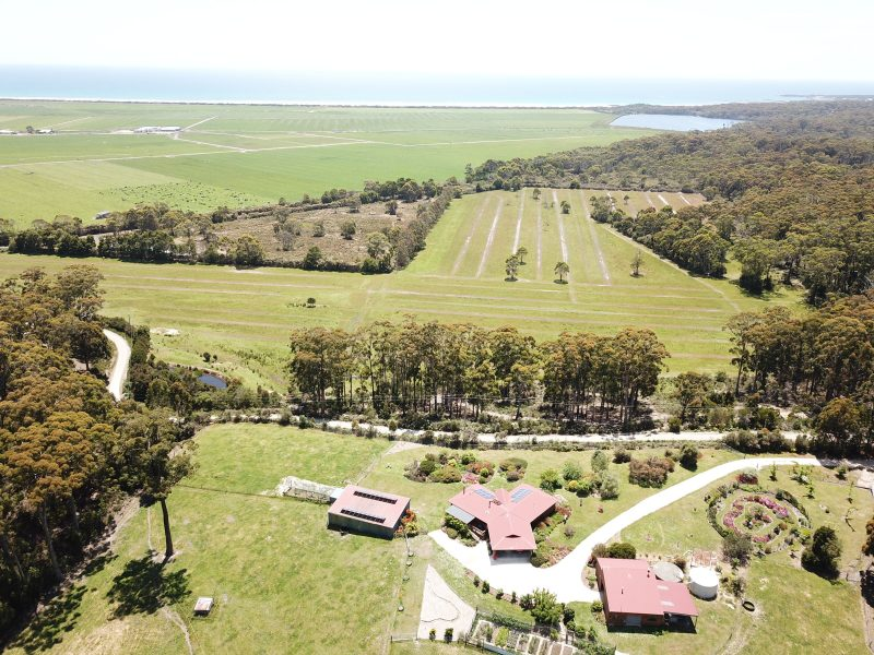 Shows the house and garden and the views beyond including the national park and the ocean.