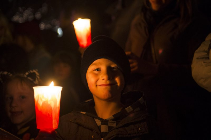 smiling boy with candle at Big Sing Bonfire Hobart