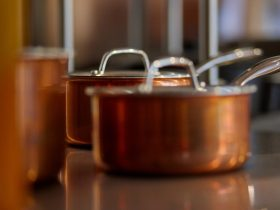 copper cooking pots on shelf