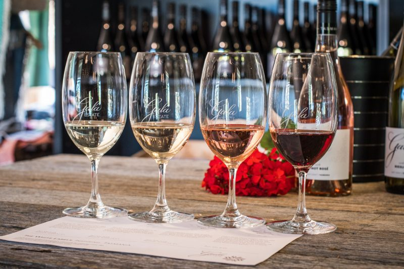 4 glasses of various wines