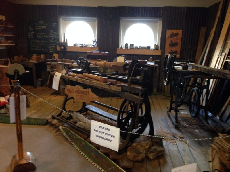 A display of a typical woodworkers workshop with lathe and tools