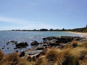 A beach and rocks