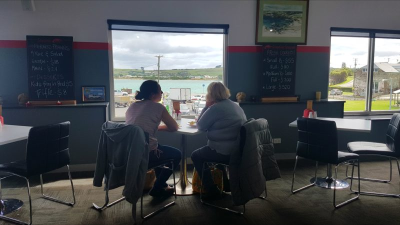 Visitors relaxed enjoying the seaside bay views