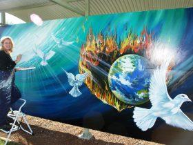 An artist painting a mural