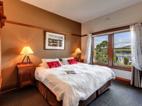 King ensuite room with water view at the Kermandie Watefront Hotel