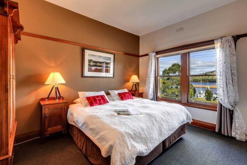 King ensuite room with water view at the Kermandie Watefront Hotel