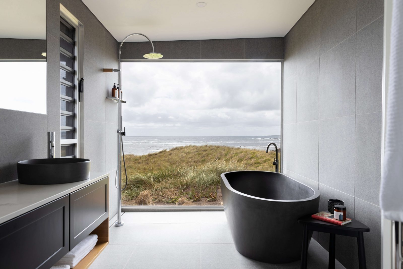 Luxuriate in your bespoke bathroom, with panoramic views of the Southern Ocean