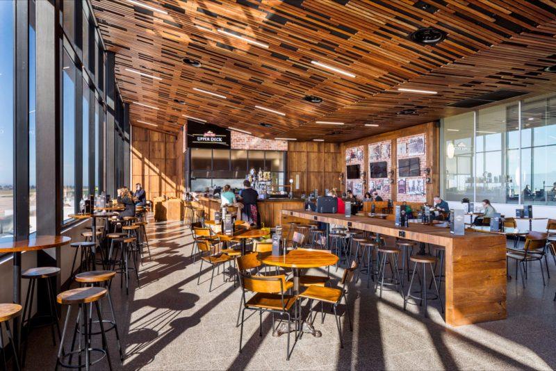 An extensive glass facade and raked timber ceiling adorns the award-winning Boags Bar & Restaurant