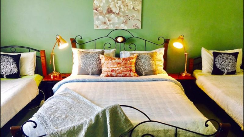 Bedroom two - Queen Bed & two single beds