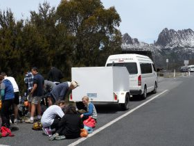 A school group prepairing to set out on the Overland Track Walk, our bus in background