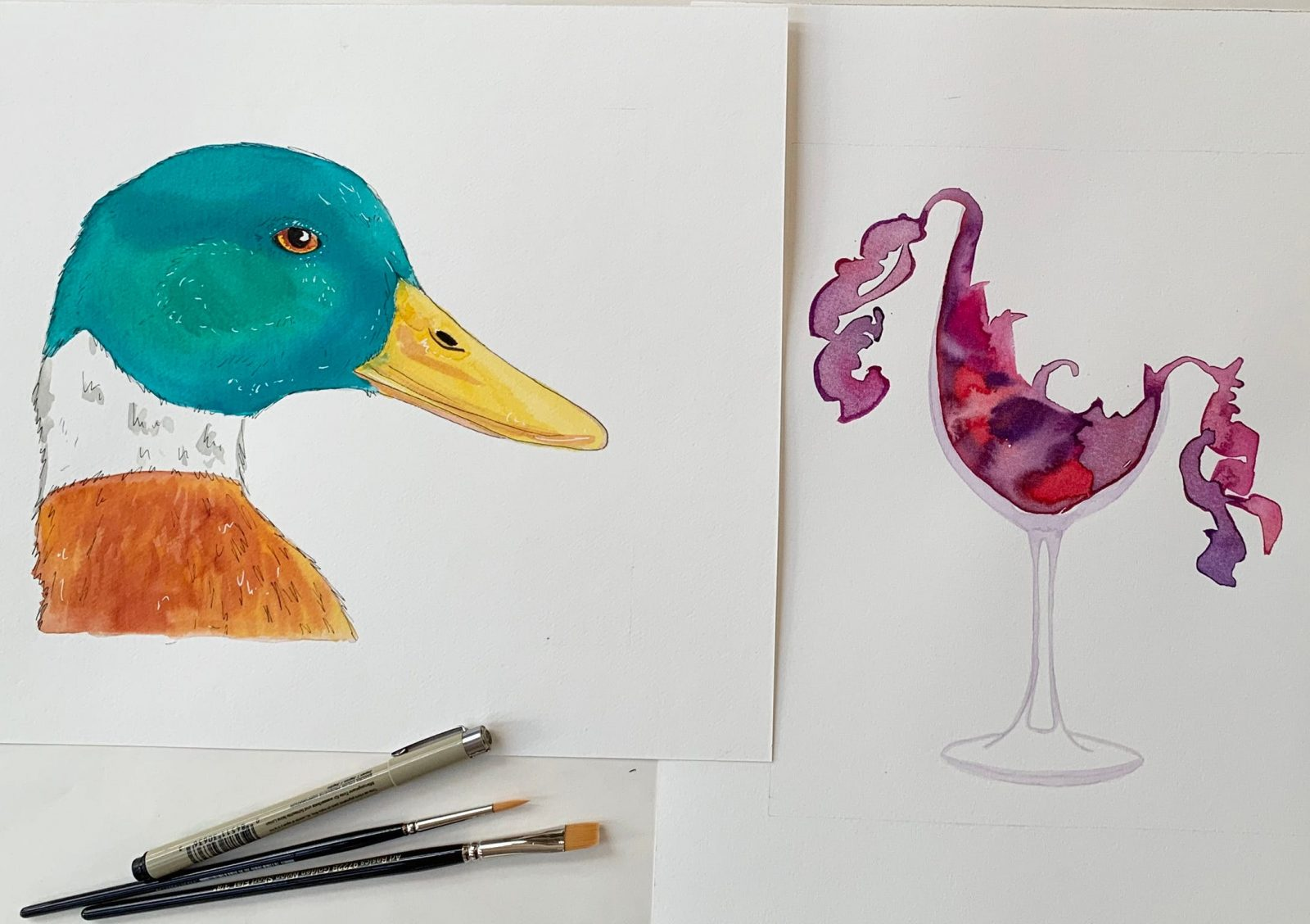A painting of a duck and a wine glass with brushes and pen