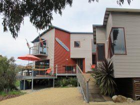 Architect designed colourbond cladFront ramp and decks.