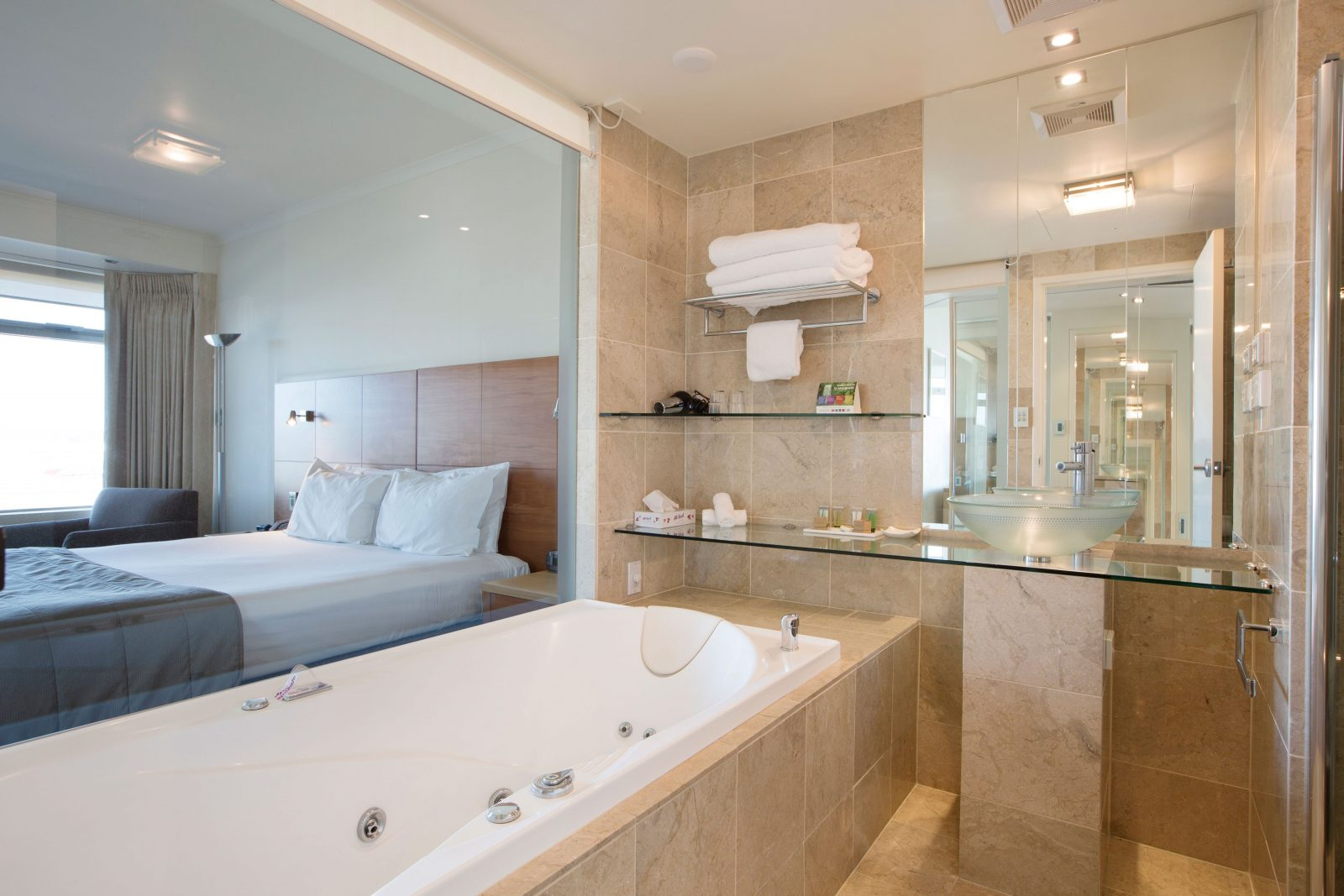 Deluxe Spa Room features a king size bed and luxury bathroom with spa
