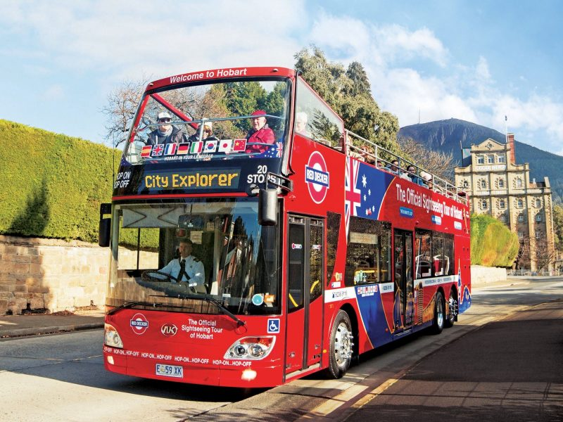Double decker bus with Cascade Brewery and kunanyi/Mt Wellington in the background.