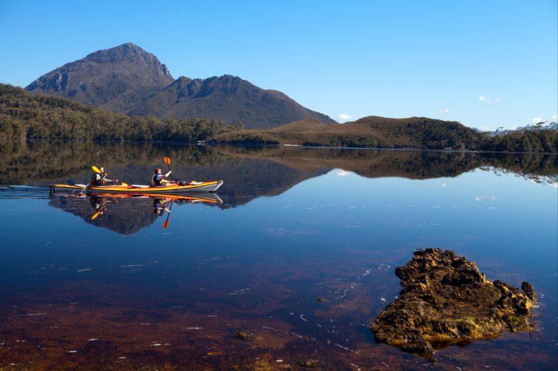 Kayakers on Forest Lagoon, Bathurst Harbour in Southwest Tasmania