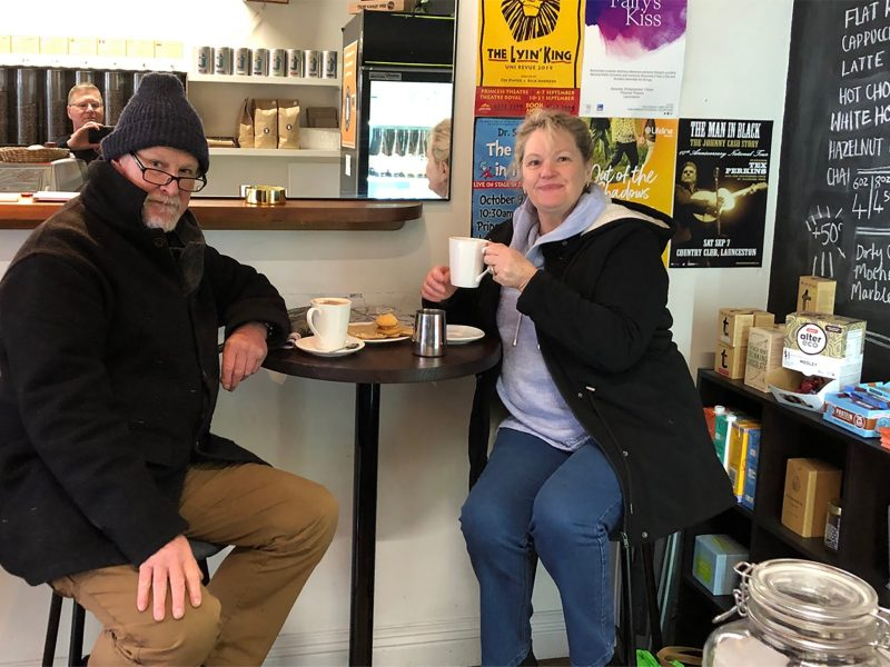 couple enjoying a brew at Roasted Coffee House