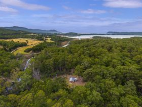Aerial view of Saintys Creek Cottage looking out along the creek to Cloudy Bay Lagoon