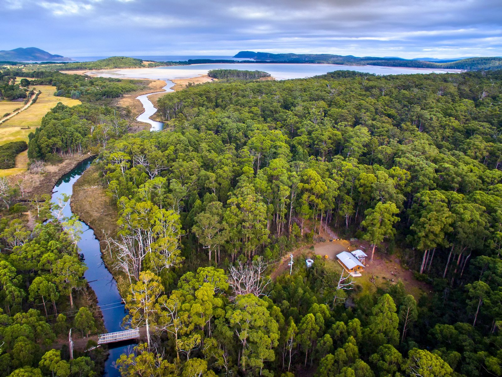 Saintys Creek Cottage: aerial view of Saintys Creek Cottage's forest and creek.