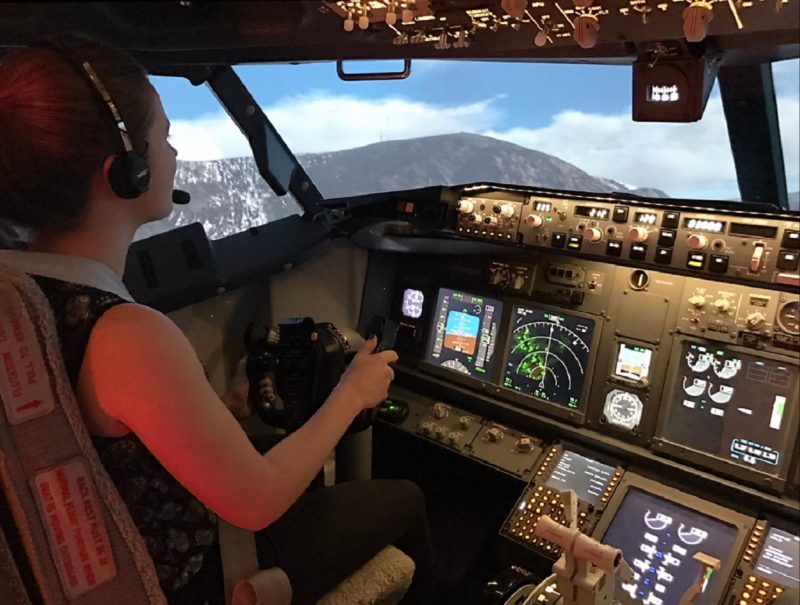 girl in flight simulator touring Hobart