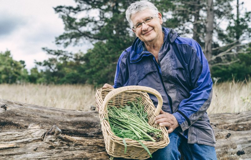 Mic Giuliani with a basket of foraged asparagus