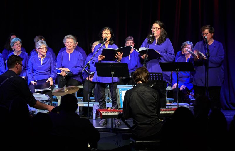 Some of the choir members singing at Moonah Arts Centre