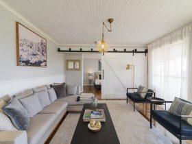 Living room with beautiful designer barn doors