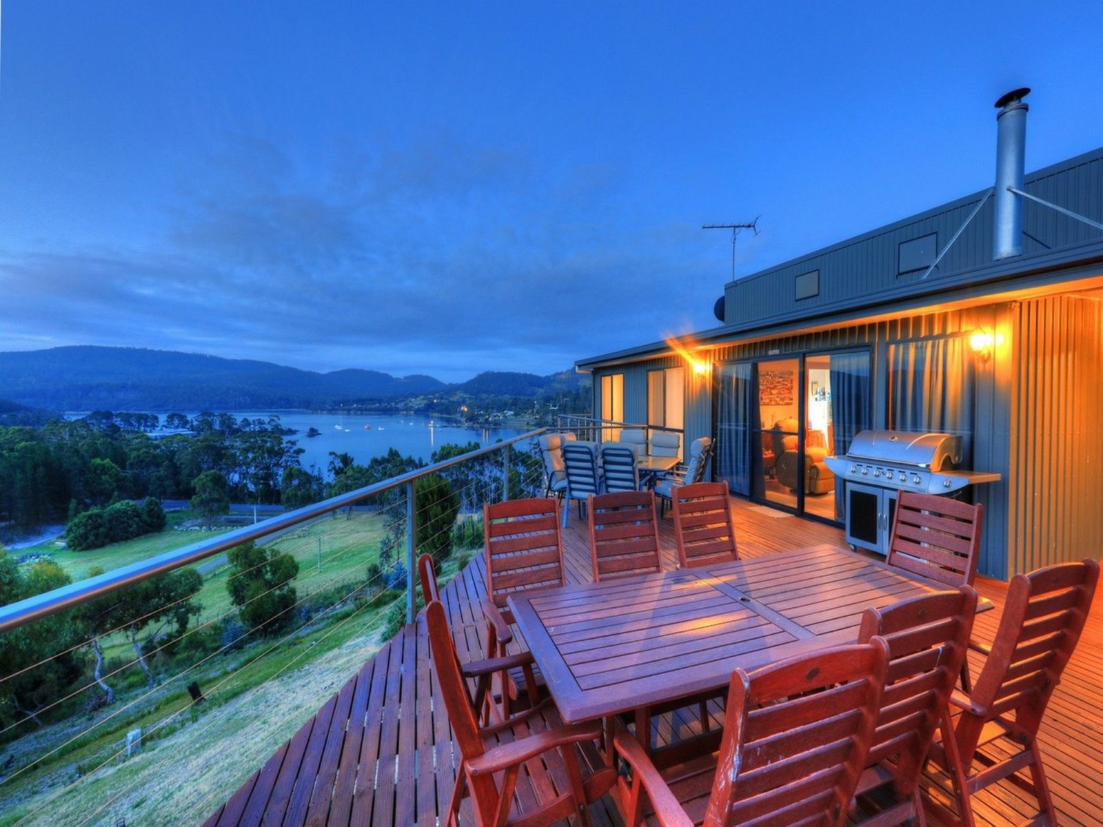 An outdoor deck provides stunnning views to Bruny Island, Storm Bay and the Hartz Mountains.