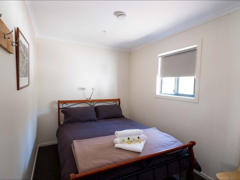 Cosy double room in the Tahune Lodge, comfortable queen size bed.