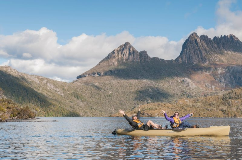 A couple canoing on Dove Lake at Cradle Mountain