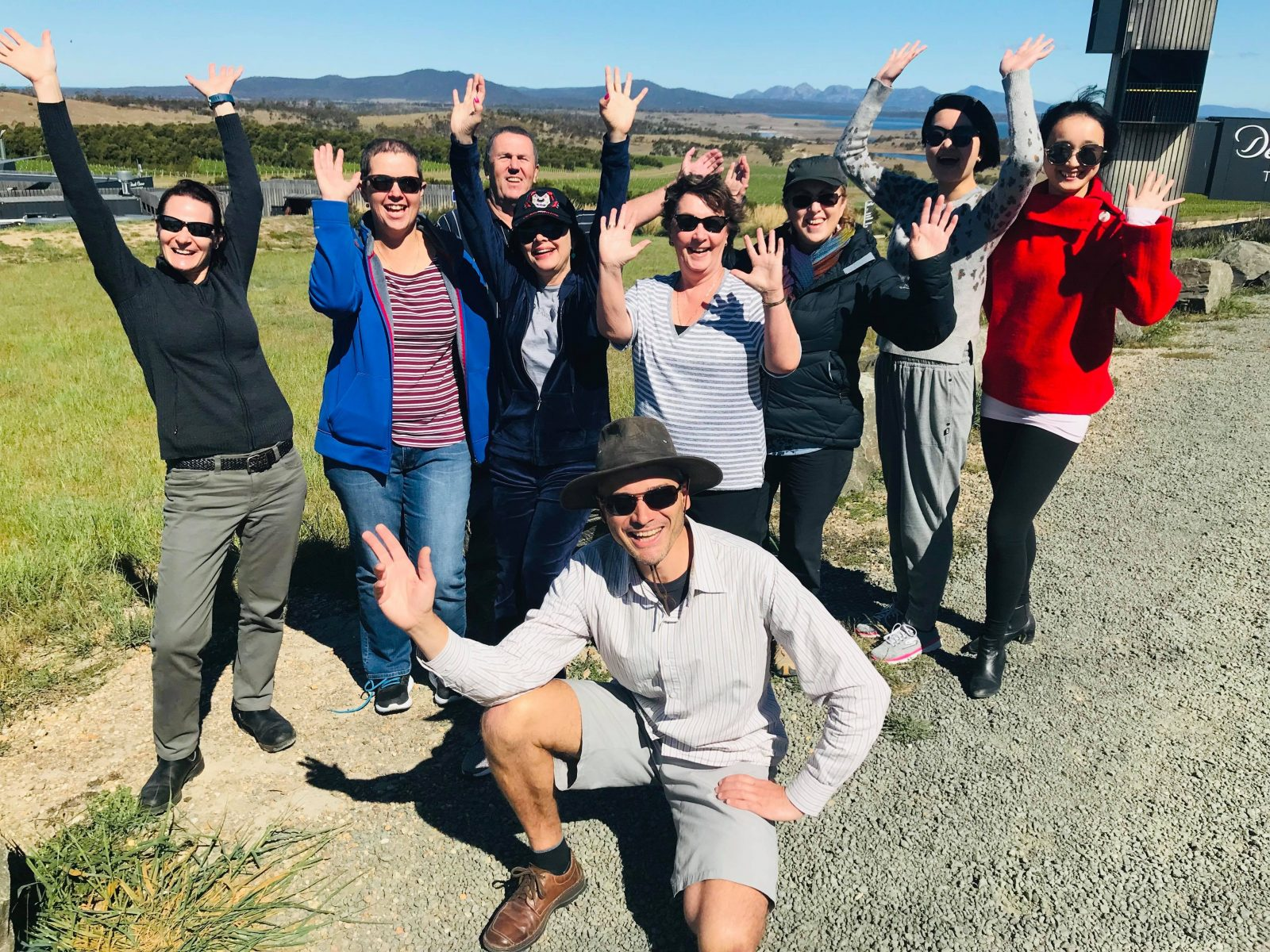 A tour group in Tasmania waving