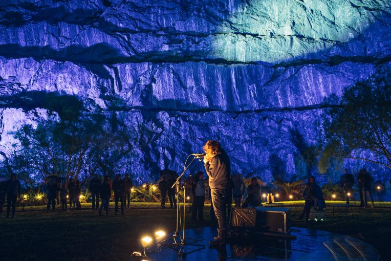 New Zealand artist Rob Thorne playing to audiences in an abandoned limestone quarry in Queenstown